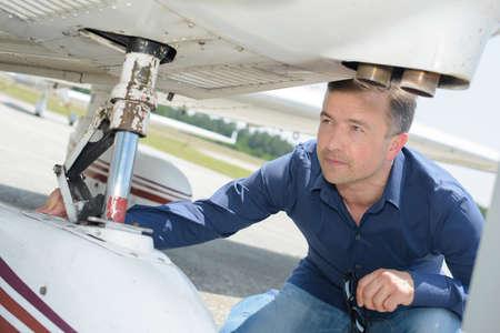 reassurance: Man checking aircraft