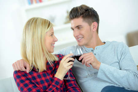 comfort: Couple drinking red wine on the sofa Stock Photo