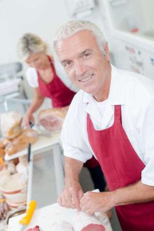 prime adult: Butcher serving a female customer