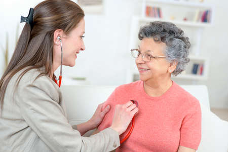 senior female: Need to check old ladys pulse Stock Photo