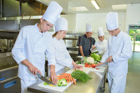trainees: Chef supervising team of trainees