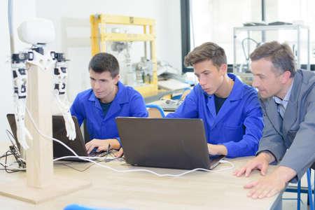 Teacher with robotics students