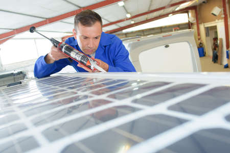 cheaper: installing solar panel roofing Stock Photo