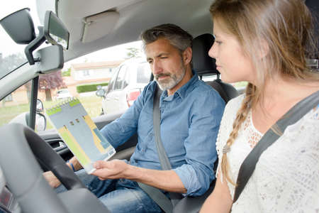 Lady with driving instructor, learning theory