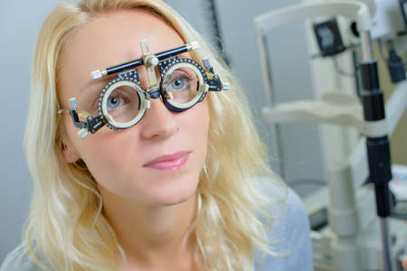 testing vision: Lady wearing opticians testing glasses