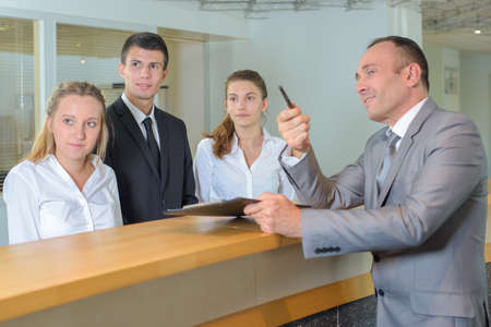 hotel staff: Hotel staff following supervisors gaze