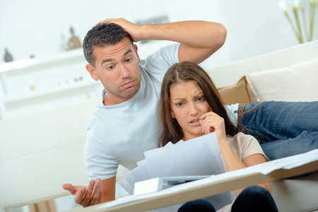 bother: Couple stressed by bills Stock Photo