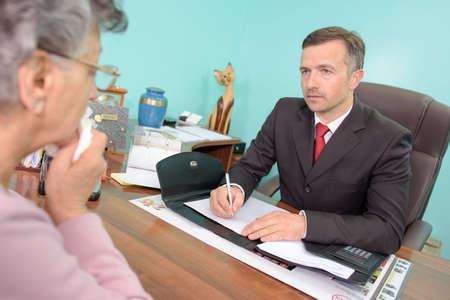 bereaved: Funeral director talking to bereaved woman
