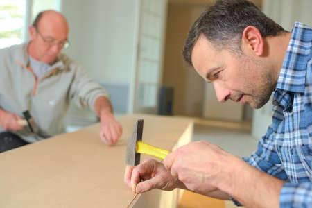 housebuilding: Carpetners at work