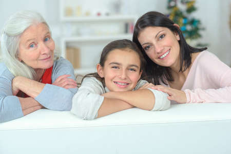 three generations: Little girl with her grandma and mother