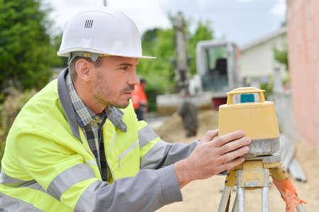 measurements: Surveyor taking some measurements Stock Photo