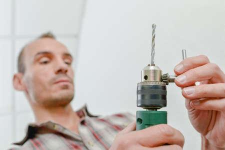 bit: Changing a drill bit Stock Photo
