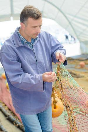 untangle: Fisherman holding net