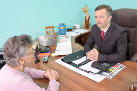 Man in meeting with elderly lady