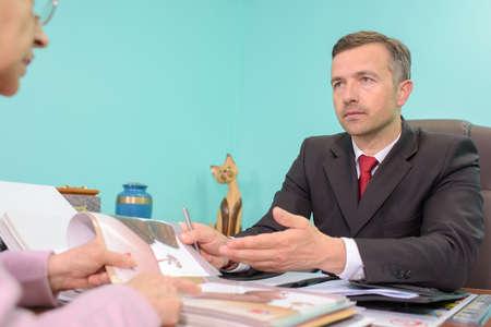 persuades: man in suit Stock Photo