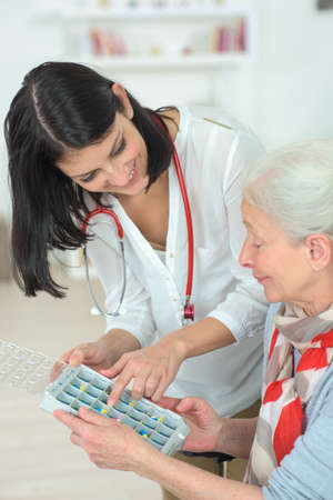 carer: Carer explaining how medication is organised