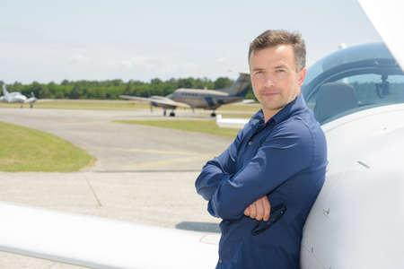 stood: Portrait of pilot stood next to aircraft