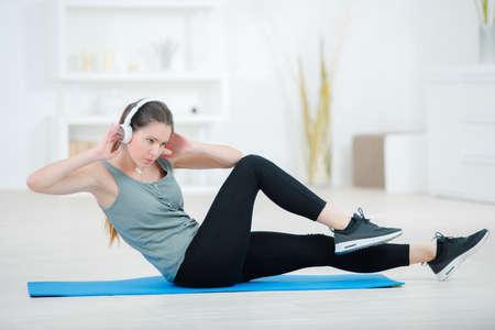 excercise: Lady exercising wearing headphones