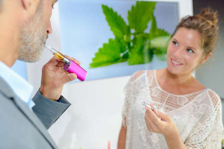 puffing: puffing an e-cigarette Stock Photo