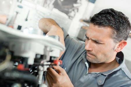 toolroom: Man using machinery