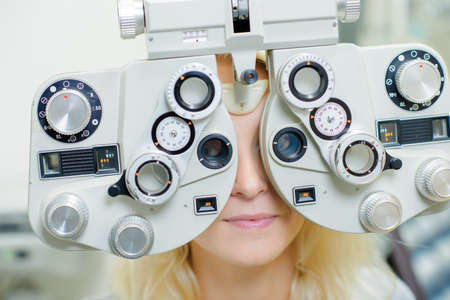 long sightedness: lady having eye examination Stock Photo