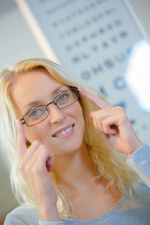 woman  glasses: Woman at the opticians Stock Photo
