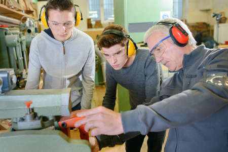 anti noise: Senior carpenter with two learners