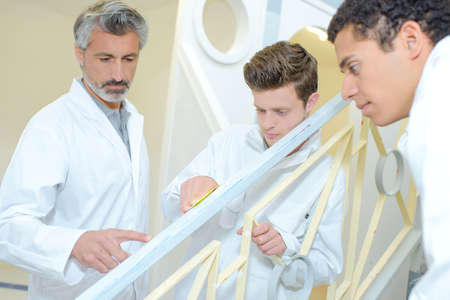 repaint: Apprentices preparing surface to repaint