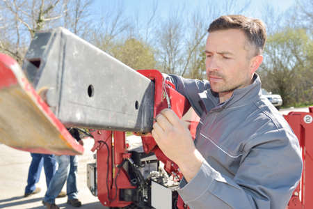 machinery: Workman setting up machinery