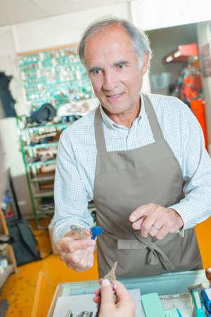 Customer having a spare key cut Stock Photo
