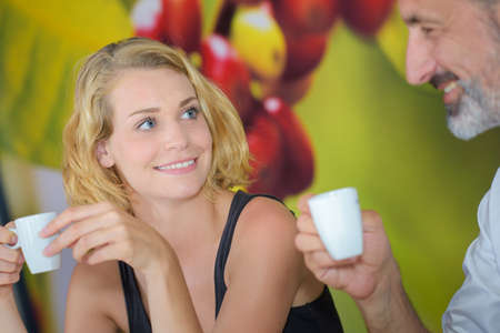 father daughter: coffee cups Stock Photo