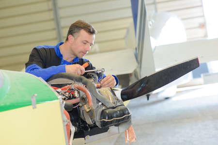 light aircraft: Man working on light aircraft