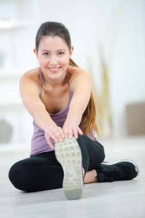 supple: Woman stretching before a run
