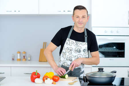 prep: Man chopping vegetables Stock Photo
