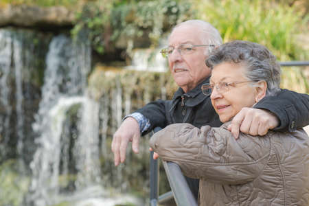 a meeting with a view to marriage: elderly couple and a waterfall