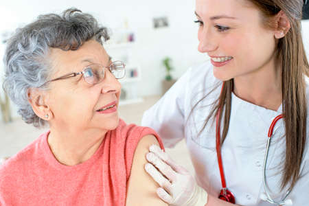 flu shot: Senior woman getting a jab