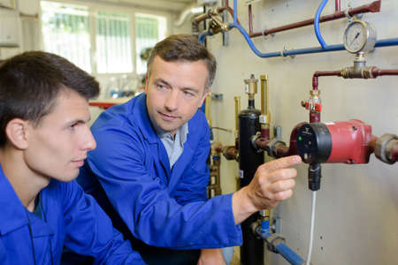pipework: Plumber showing pipework to apprentice