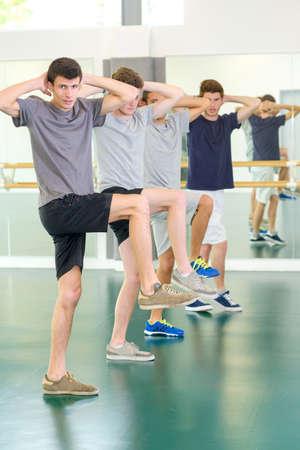 men exercising: Young men exercising