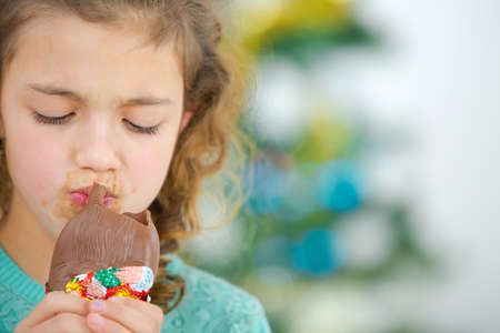 greedy: Greedy little girl eating chocolate Stock Photo