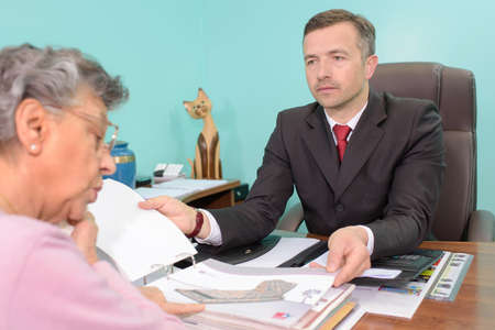 deadpan: Undertaker in meeting with elderly lady Stock Photo