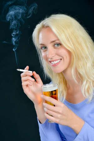 Woman drinking and smoking