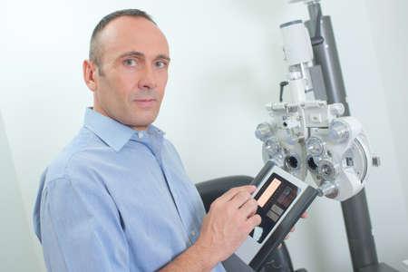 computerised: Optician preparaing equipment