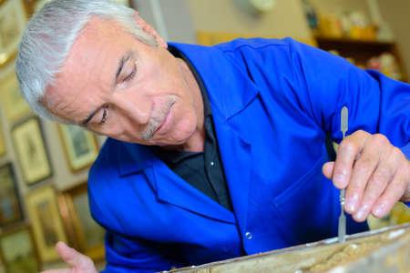 Man doing precision restoration work