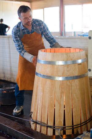 slack: cooper making a barrel Stock Photo