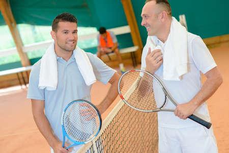 having tennis conversation Stock Photo