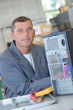 motherboard: repairing a motherboard Stock Photo