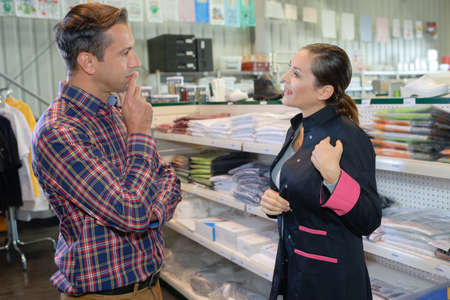 Man and woman in stationary store