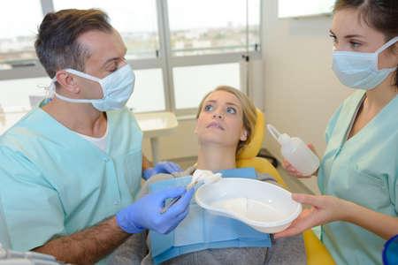 dental fear: portrait of terrified woman scared at dentist