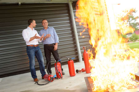 fire show: fire extinguisher demonstration Stock Photo