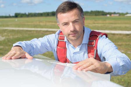 Pilot inspecting sailplane Stock Photo
